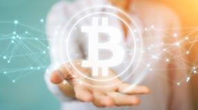 Empresaria que usa la representación del cryptocurrency 3D de los bitcoins Foto de archivo libre de regalías