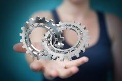 Empresaria que usa la representación moderna flotante del mecanismo de engranaje 3D Imagen de archivo libre de regalías