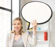 Empresaria sonriente con la burbuja en blanco del texto Foto de archivo