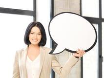 Empresaria sonriente con la burbuja en blanco del texto Imagenes de archivo