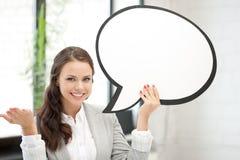 Empresaria sonriente con la burbuja en blanco del texto Foto de archivo libre de regalías
