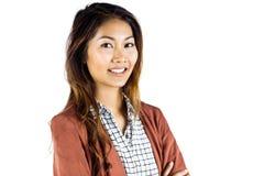 Empresaria sonriente con los brazos cruzados Fotos de archivo libres de regalías