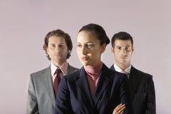 Empresaria Standing In Front Of Businessmen imagenes de archivo