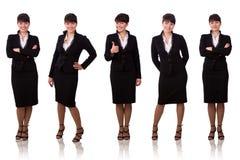 Empresaria triguena vestida en juego negro. Foto de archivo