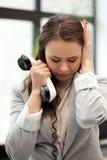 Empresaria triste con el teléfono Fotos de archivo