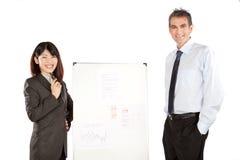 Empresaria y hombre de negocios Giving Presentation fotos de archivo