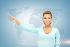 Empresaria y mapa del mundo Foto de archivo libre de regalías