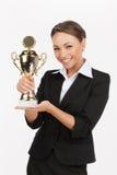 Empresarias con el trofeo del negocio. Foto de archivo libre de regalías