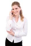 Empresarias jovenes en el teléfono móvil Imagen de archivo libre de regalías