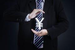 Empresario con símbolo de moneda de los yenes Imagen de archivo libre de regalías