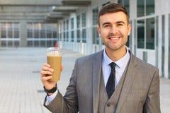 Empresario con una obsesión del café imagen de archivo libre de regalías
