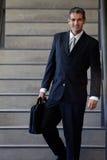 Empresario de sexo masculino Walking Down Stairs Fotos de archivo