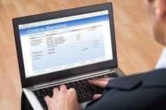 Empresario Doing Online Banking imagen de archivo libre de regalías