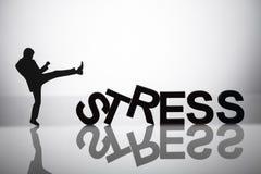 Empresario Kicking Stress Word imagen de archivo libre de regalías
