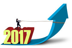 Empresario y números 2017 flechas de tracción hacia arriba Imágenes de archivo libres de regalías