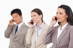 Empresarios en el teléfono Imagen de archivo libre de regalías