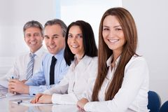 Empresarios felices en fila Imagenes de archivo