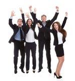 Empresarios felices que saltan en alegría Fotos de archivo