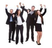 Empresarios felices que saltan en alegría Fotografía de archivo