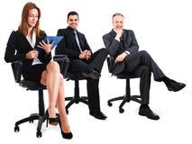 Empresarios que se sientan Imagen de archivo libre de regalías