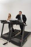 Empresários em uma escada rolante - vertical Fotografia de Stock Royalty Free