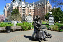 Empress hotel and Emily Carr statue in Victoria BC,Canada. Victoria`s finest accommodations across from its famous inner harbor is a class all its own,A bronze Royalty Free Stock Image