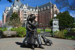Empress hotel and Emily Carr statue in Victoria BC,Canada. Victoria`s finest accommodations across from its famous inner harbor is a class all its own,A bronze Stock Photography
