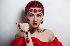 Empress medieval ball. Young beautiful girl model woman Empress Queen character ball fairytale. Medieval creative theatrical style. Art bright makeup red cheeks stock photo