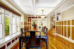 Empressive dining room interior. Luxury house with wood trim Royalty Free Stock Photo