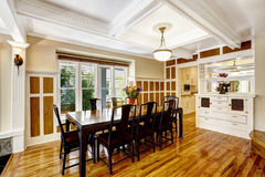 Empressive dining room interior. Luxury house with wood trim Stock Images