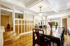 Empressive dining room interior. Luxury house with wood trim Royalty Free Stock Photography