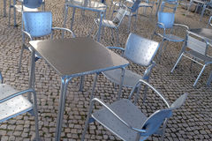 Empry Silver Chairs. Empty modern silver chairs and tables in a terrace Royalty Free Stock Photos