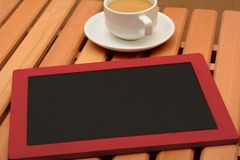 Empt Slate chalkboard with cup of tea with copy space.  Royalty Free Stock Image