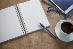 Empt white paper diary on coffee table. Empt white paper  diary on coffee table Royalty Free Stock Photography
