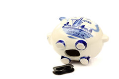 Emptied ceramic Delft Blue piggy bank Stock Photos