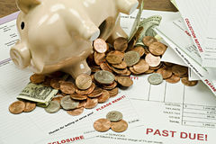 Emptied Piggy Bank With Past-due Bills Stock Images