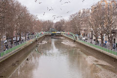 The empting of the canal St-Martin with trash  in the riverbed a Royalty Free Stock Image