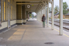 Almost emptry train station. Lonely busy women at train station Royalty Free Stock Photography