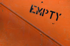Empty. The side of an orange metal container Stock Photos