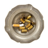 Empty 9mm bullet casings in an old tin ashtray. Isolated Stock Image