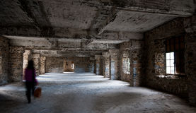Empty abandoned creepy room whit ghost walking Stock Image