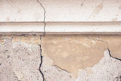 Empty abandoned urban interior fragment. Old cracked concrete wall with stucco moulding Stock Photography