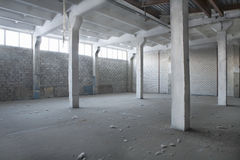 Empty Abandoned Warehouse. Interior of an empty abandoned warehouse royalty free stock photo