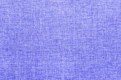 Burlap background colored in blue and white blend royalty free stock image