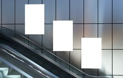 Empty advertising billboards and escalator stairs Stock Images