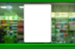 Empty advertising board. In drugstore showcase. Blurry background royalty free stock images