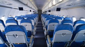 Empty aircraft cabin during flight. Blue salon. stock image