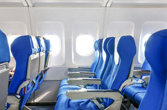 Empty aircraft seats. And windows Royalty Free Stock Photos