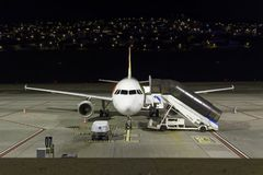 Empty airplane in the night at Funchal airport on Madeira island. Funchal, Portugal - September 21, 2018: Empty airplane in the night at Funchal airport on royalty free stock images