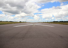 Empty airplane runway with white cross Stock Photos